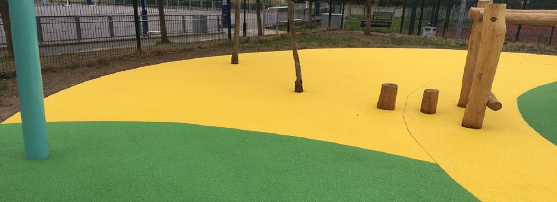 Wetpour Surfacing Installation in Wembley