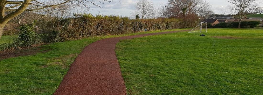 Rubber Mulch Track Installation in Coventry