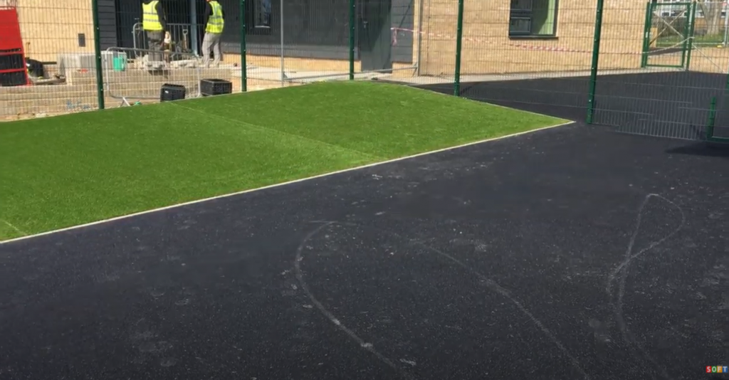 Black Wetpour & Artificial Turf Construction at a Nursery in Harlow, Essex