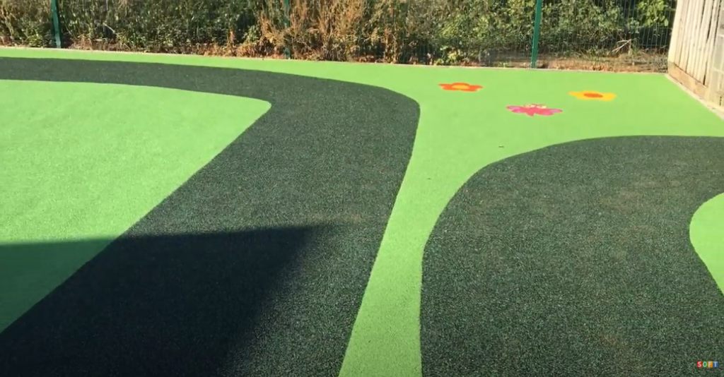 Green Wetpour Flooring with Graphics Install in Exeter