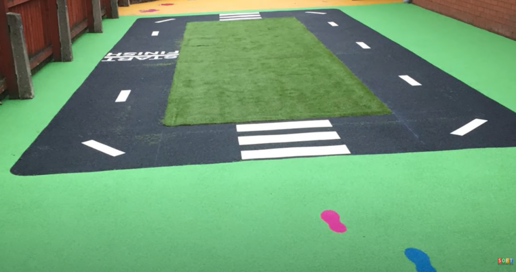 Rubber Playground Flooring With Artificial Grass in Worthing, West Sussex