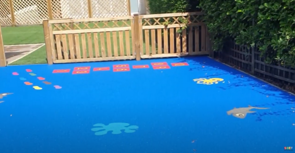 Wetpour Playground with Graphics in Salford, Greater Manchester
